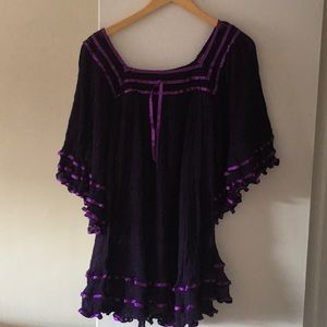 A beach coverup in purple, one size fits most!